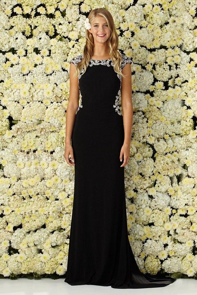 3350cbbc83a8 Luxusné čierne spoločenské šaty zdobené kamienkami